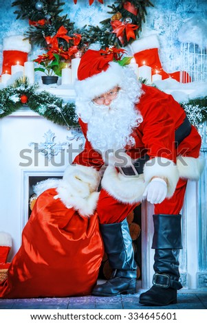 Jolly Santa Claus brought the sack with gifts. Christmas interior decoration. Merry Christmas.