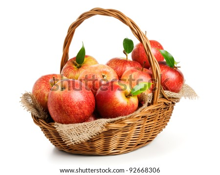 Jonagold apples in a basket on white background - stock photo