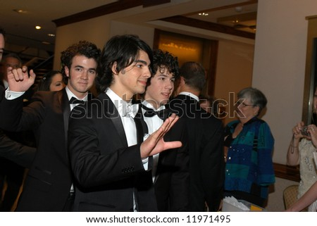 Jonas Brothers arrive at the White House Correspondents' Dinner April 26, 2008 in Washington, DC. - stock photo