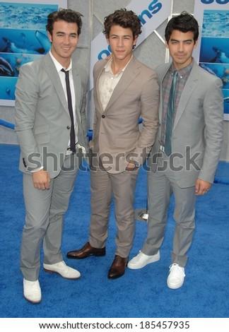 Jonas Brothers, Kevin Jonas, Nick Jonas, Joe Jonas at Disneynature OCEANS Premiere, El Capitan Theatre, Los Angeles, CA April 17, 2010 - stock photo