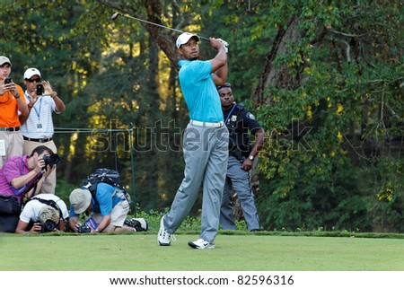 JONHS CREEK, GEORGIA, USA - AUGUST 10: Tiger Woods takes a shot during practice rounds at the 2011 PGA Championship tournament on August 10, 2011 in Johns Creek, Georgia, USA. - stock photo