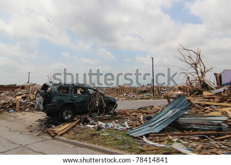 JOPLIN, MISSOURI - MAY 22: A black SUV and a bark striped tree take center stage in this shot of massive destruction after a monster EF5 tornado swept through the heart of Joplin, Missouri on May 22, 2011.