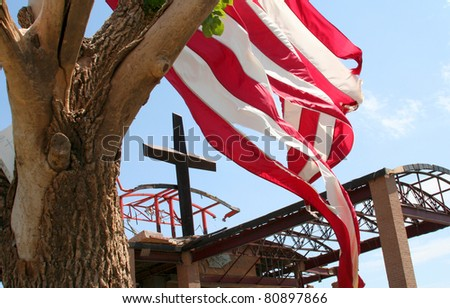 JOPLIN, MO USA--JULY 12:  The cross and the flag at St. Mary's Catholic Church  in Joplin, MO that was destroyed by an EF-5 tornado that hit on May 22, 2011. - stock photo