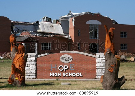 "JOPLIN, MO USA--JULY 12:  The Joplin High School after the EF-5 tornado on May 22, 2011.  With 2 letters from ""Joplin"" that survived the storm, someone added duct tape to form the word ""hope."""