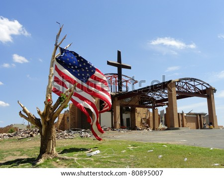 JOPLIN, MO, USA--JUNE 12:  The cross and the flag at St Mary's Catholic Church in Joplin, MO where the EF-5 tornado passed on May 22, 2011.