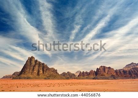 Jordan. Wadi Rum. Seven Pillars of Wisdom (on left) - stock photo