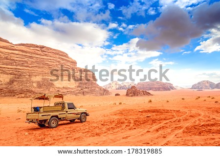 Jordanian desert in Wadi Rum, Jordan. Wadi Rum is known as The Valley of the Moon and a UNESCO World Heritage Site. - stock photo
