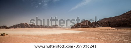 Jordanian desert of Wadi Rum in Jordan. Wadi Rum is known as the Valley of the Moon and the UNESCO World Heritage List. - stock photo