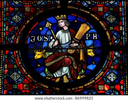Joseph (son of Jacob), mentioned in Genesis Stained glass window in the Notre Dame church of Dinant, Belgium. - stock photo