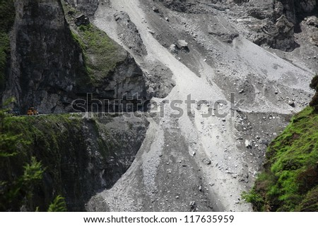 JOSHIMATH, INDIA - AUG 3 : Roads leading to Joshimath are affected by landslides on August 3, 2012 in Joshimath, Uttrakhand, India. Landslides and rockfalls are often happening in this region.
