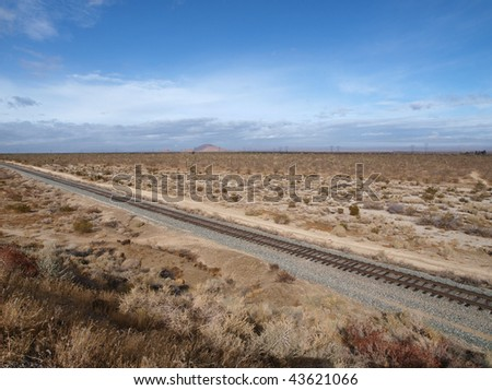 Joshua Trees and Railroad tracks crossing California's Mojave Desert.