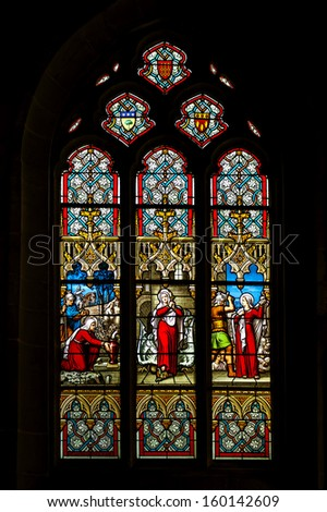 JOSSELIN, FRANCE - CIRCA APRIL 2013. Colorful windows of the church of Josselin village in Brittany, France