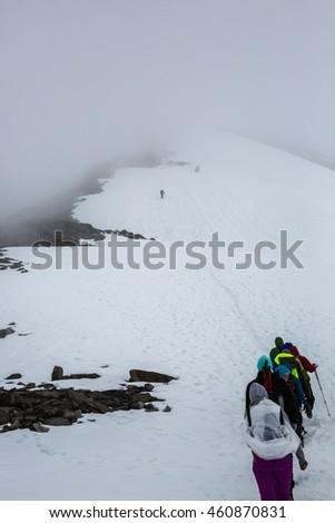 JOTUNHEIMEN, NORWAY-JULY 9: Way to the Galdhopiggen July 9, 2016 in Jotunheimen, Norway. Trackers go to highest norway peak Galdhopiggen. - stock photo