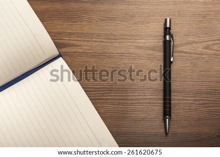 Journal. opened notebook and pen on the wooden table - stock photo