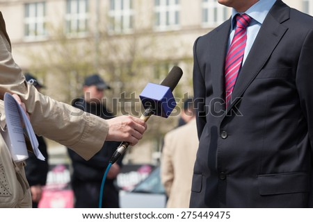 Journalist making media interview with businessman - stock photo