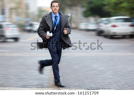 journalist rushing on city streets for breaking news - stock photo