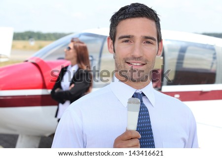 Journalists at the airport - stock photo