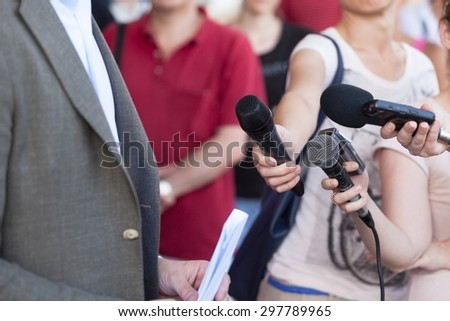 Journalists making interview with businessman or politician - stock photo