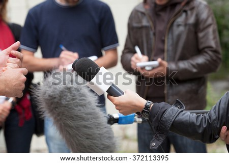 Journalists. Media interview. News conference. - stock photo