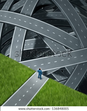 Journey confusion and facing challenges with a business man at the edge of a cliff in front of a group of tangled three dimensional roads and highways as a concept of planning and managing adversity. - stock photo