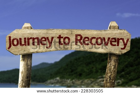 Journey to Recovery wooden sign with a beach on background - stock photo