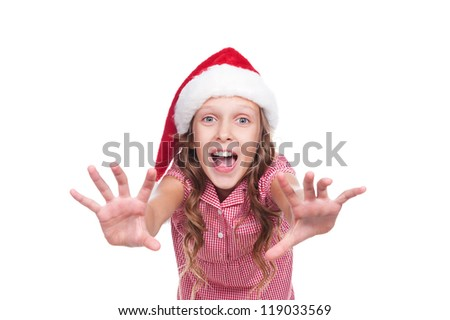 jovial girl in santa claus hat over white background - stock photo