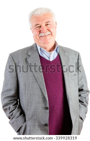 Jovial relaxed attractive senior man with white hair and a moustache standing with his hands in his pockets smiling at the camera, isolated on white - stock photo