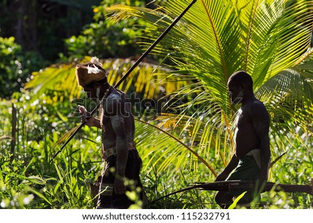 JOW VILLAGE, ASMAT DISTRICT, IRIAN JAYA PROVINCE, NEW GUINEA, INDONESIA - JUNE 28: Asmat warriors go on the jungle from a spears. June 28, 2012 in Jow Village, Asmat, Irian Jaya province, Indonesia - stock photo
