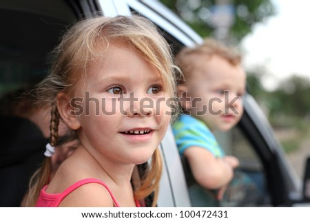 joy a child looks out from a car window - stock photo