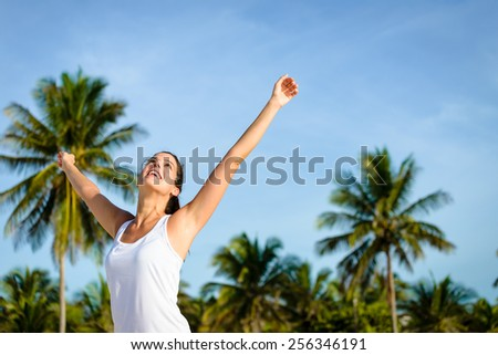 Joyful and blissful woman enjoying caribbean travel to Mayan Riviera, Mexico. Brunette caucasian girl on tropical vacation. - stock photo