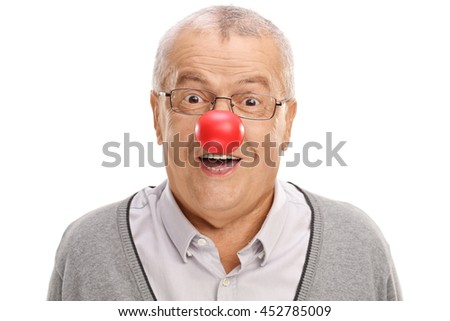 Joyful and funny mature man with a red clown nose isolated on white background  - stock photo