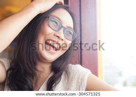 joyful asia woman.woman wear eyeglasses.joy and laugh. - stock photo