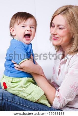 Joyful baby boy and his mother - stock photo