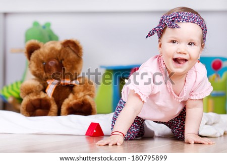 Joyful baby girl laughing  - stock photo