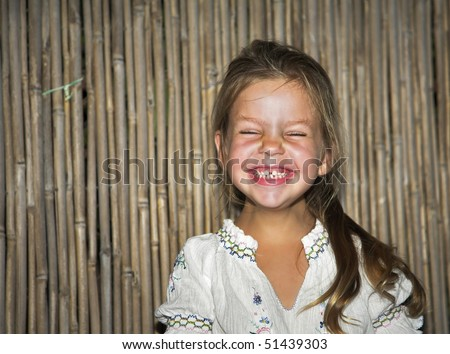 Joyful birthday at the four-year-old girl - stock photo