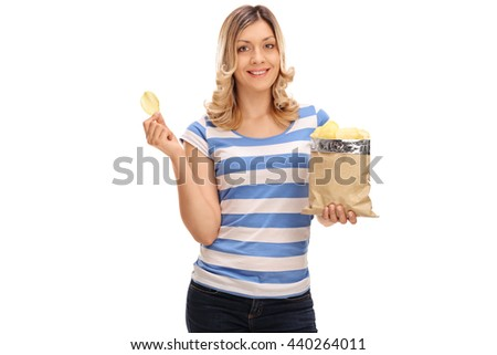 Joyful blond woman eating potato chips and looking at the camera isolated on white background - stock photo