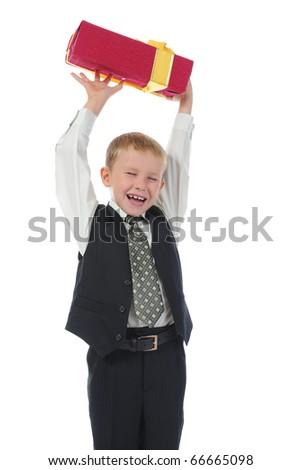 Joyful boy holding present box . Isolated on white background - stock photo
