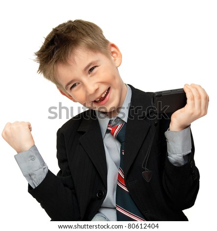 joyful boy in a suit with a cell phone - stock photo