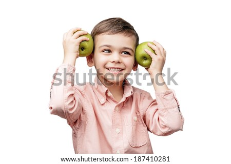 Joyful boy with a green apple on an isolated white background