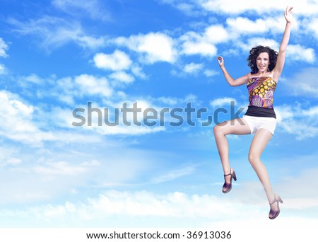 Joyful  brunette beauty jumping over sky background, lots of copy-space