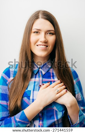 Joyful businesswoman holding hands on his chest