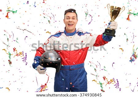 Joyful car racer holding a gold trophy and celebrating with confetti streamers around him isolated on white background - stock photo