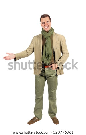 Joyful caucasian man with arm out in a welcoming gesture. Isolated on white studio background