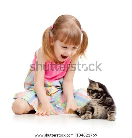 joyful child playing with baby cat - stock photo