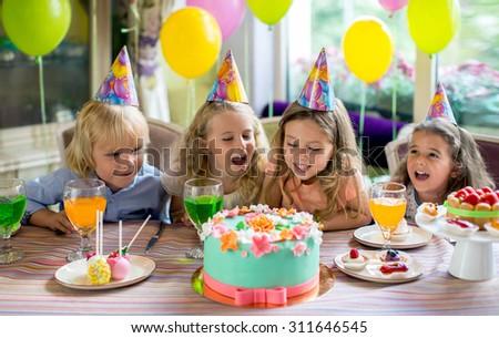 Joyful children at a birthday party - stock photo
