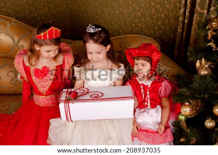 Joyful children in beautiful clothes waiting for a miracle, look for a great gift, Christmas, New Year - stock photo
