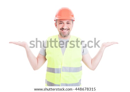 Joyful constructor raise and holding something in his palms isolated on white background with text area - stock photo