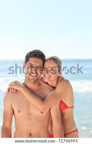 Joyful couple at the beach