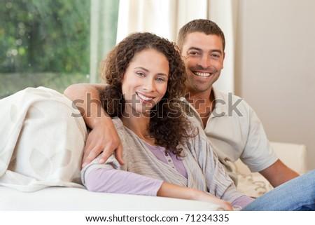 Joyful couple looking at the camera - stock photo