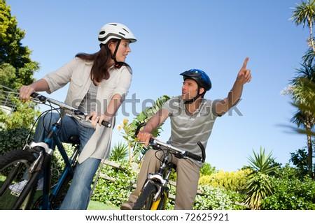 Joyful couple with their bikes - stock photo
